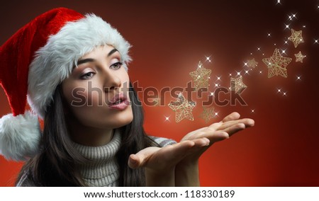girl blows the star dust - stock photo