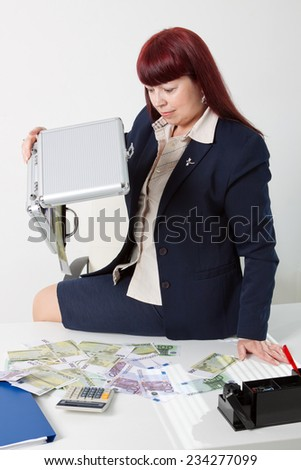girl boss with a lot of money - stock photo
