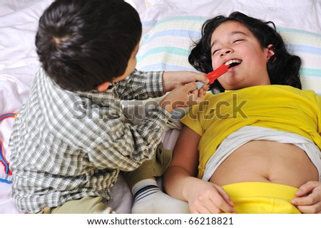 girl & boy playing like a doctor