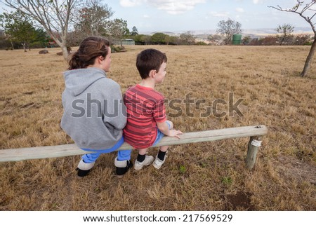Girl Boy Seated Outdoors Park Young boy girl teenager seated  together talking caring outdoors park - stock photo