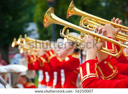 Girl Brass Band in red uniform performing - stock photo