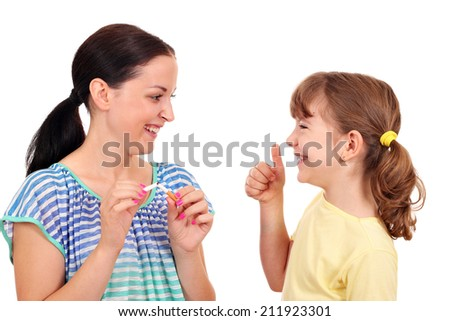girl breaks a cigarette and a little girl with thumb up  - stock photo