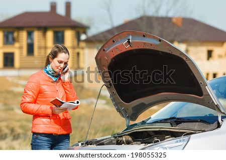 girl broken car with open hood call  service for help - stock photo