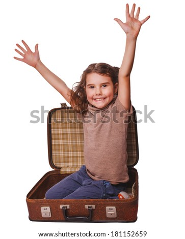 girl brunette baby sitting in suitcase for travel isolated on white background - stock photo