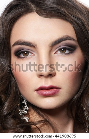 Girl brunette face close-up, make-up, hair and beauty. - stock photo