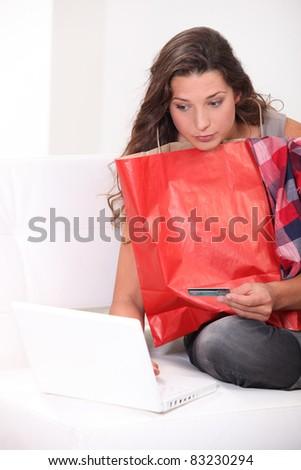 Girl Brunette shopping online - stock photo