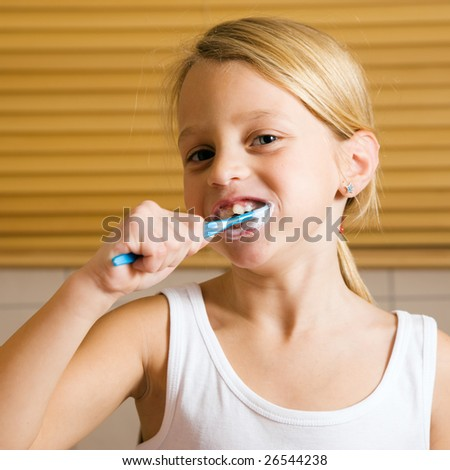 Girl brushing her teeth - stock photo