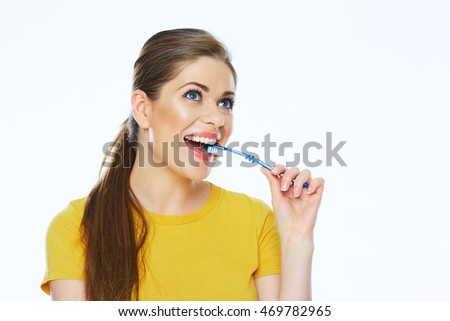 Girl brushing teeth. young woman with toothy brush. white background isolated.