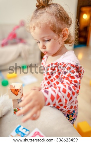 Girl build a tower of cubes - stock photo