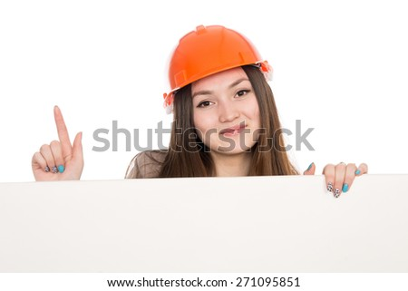 Girl builder in helmet showing thumbs up with blank banner. Asian cheerful young female model displays ads. Isolated on a white background - stock photo