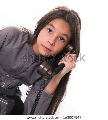 girl calling by retro phone, partly isolated on the white - stock photo