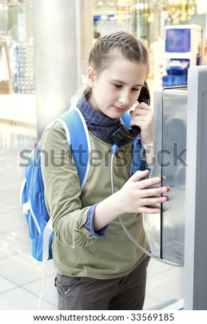 Girl calling parents from airport