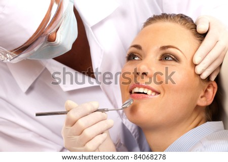 girl came for a visit to the dentist - stock photo