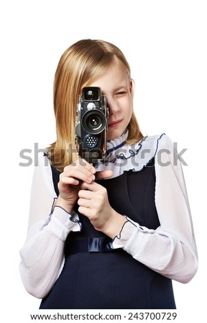 Girl cameraman filming with retro camera isolated - stock photo