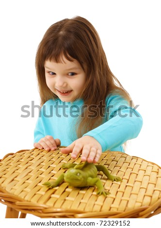 Girl cautiously stroking a toy lizard isolated on white background - stock photo