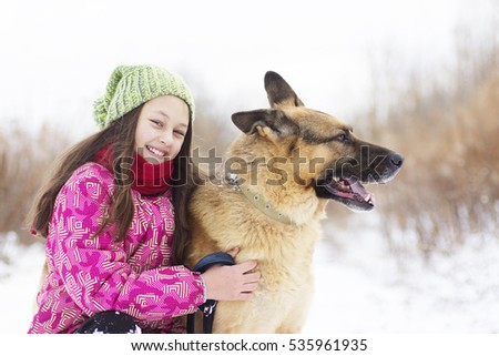 girl child and dog Shepherd