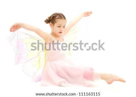 Girl child dressed in butterfly ballerina costume. Isolated on white.