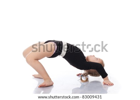 Girl child performing backward bend gymnastics isolated on white background
