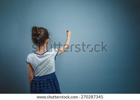 Girl Child Teen seven years, European appearance brunette turned - stock photo