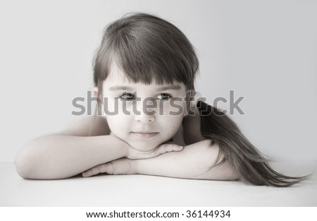 Girl child with a sly glance - stock photo