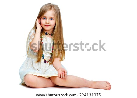 girl child with long blond hair siting on a floor.fashion portrait isolated on white background.  - stock photo