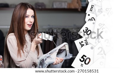 Girl chooses an expensive dress on sell-out - stock photo