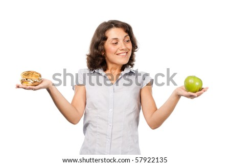 Girl chooses between a green apple and hamburger - stock photo