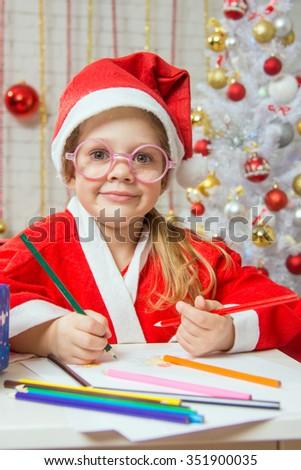 Girl Christmas gnome drawing card for Christmas - stock photo