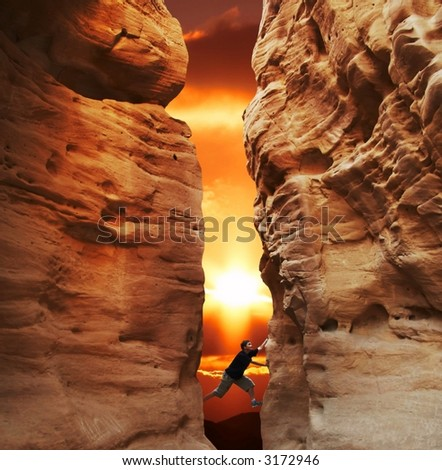 Girl climbing in canyon walls on sunset - stock photo