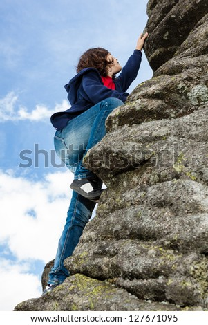 Girl climbing mountains