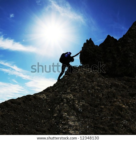 girl climbing on the rock - stock photo