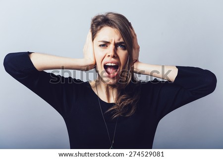 girl closed her hands over her ears - stock photo