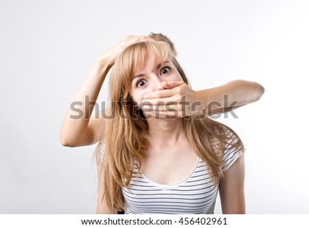 Girl closed up mouth another girl. She is shocked and surprised - stock photo