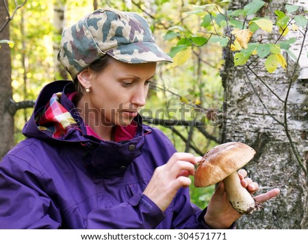 girl collect cep boletus on forest - stock photo