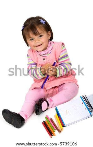 girl colouring on a notebook isolated over a white background