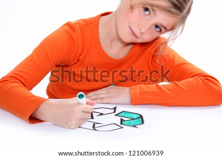 Girl colouring recycling sign - stock photo