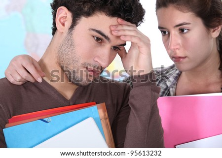 Girl consoling fellow student - stock photo
