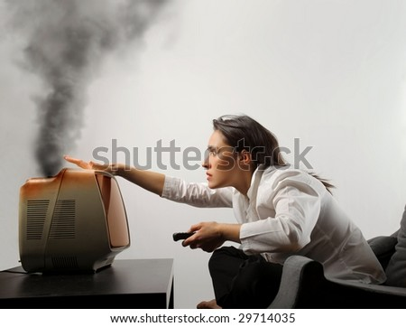 girl controlling an old broken tv - stock photo