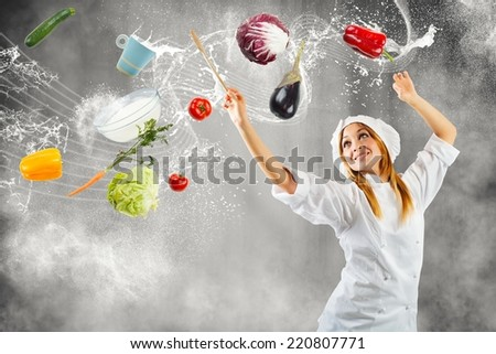 Girl cooking as a master of symphonic orchestra - stock photo