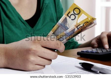 Girl counting money - stock photo