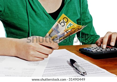 Girl counting money against white background - stock photo