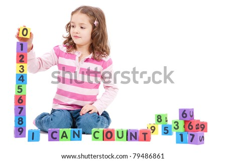 Girl counting numbers with blocks and saying I can count. Isolated on White - stock photo
