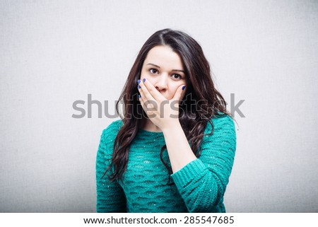 girl covering her mouth with his hand - stock photo