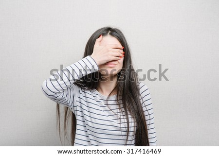 girl covers her face with hands - stock photo