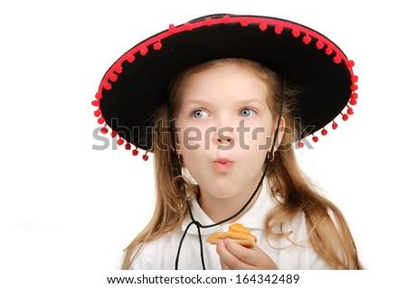 Girl cowboy eats hot dog. - stock photo