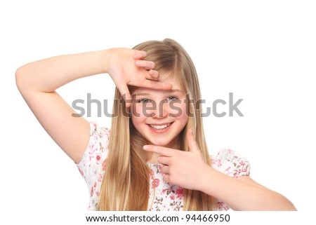 girl creates a frame with her fingers - stock photo