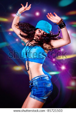 girl dancing in discolight - stock photo
