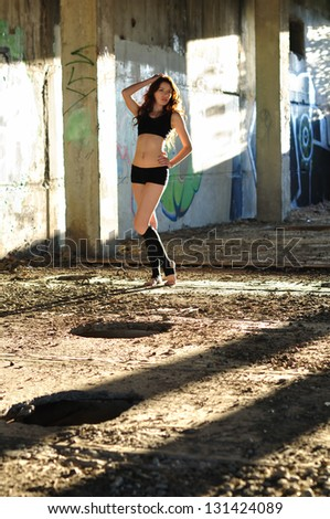 Girl dancing in the abandoned room - stock photo