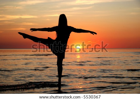 girl dancing in the water - stock photo