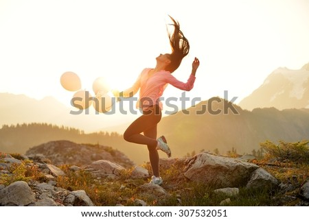 Girl dancing on Artist Point at sunrise, Mt. Baker, Washington